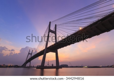 HO CHI MINH city, VIETNAM - AUGUST 12, 2014: Phu My brigde, This is the important bridge linking district 2 and district 7. Photos were taken in sunset, with red sky.