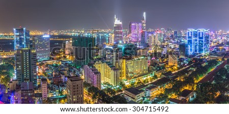 Ho Chi Minh City, Vietnam - August 6th, 2015: Drawing beautiful urban architecture, impressive multicolored light from the darkness down in District 1, Ho Chi Minh City, Vietnam