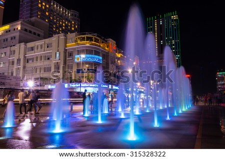 Ho Chi Minh City, Vietnam - August 12, 2015: the illuminated fountain on Nguyen Hue Pedestrian Street in District 1 erupts hourly. The fountain was completed in 2015. - stock photo