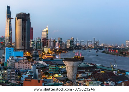 HO CHI MINH CITY, VIETNAM - CIRCA JAN, 2016: Top view of Ho Chi Minh City (Saigon) at night time. Is located in the South of Vietnam, is the country's largest city, population 8 million. - stock photo