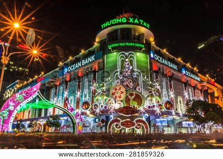 HO CHI MINH CITY, VIETNAM - DEC 25: Saigon Tax Trade Center by night on DEC 25, 2013 in Ho Chi Minh City. Tax Center is the market where you can buy digital