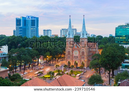 HO CHI MINH CITY / VIETNAM - DEC 17 2014: sunset or sunrise at Night view Notre Dame Cathedral ( Saigon Notre-Dame Basilica ), downtown of Ho Chi Minh City, Vietnam, established by French colonists - stock photo