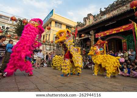 Ho Chi Minh City, Vietnam - February 18, 2015: A show of lion dance at Pagoda, China Town, District 5, Cho Lon to praying heathty, safety and lucky during the lunar new year. - stock photo