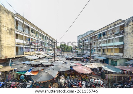 HO CHI MINH CITY, VIETNAM - MARCH 15, 2015: Typical of Old apartment buildings in Ho Chi Minh City. Impression scene of cement wall, group of aged window, air conditioner, block downgrade  - stock photo