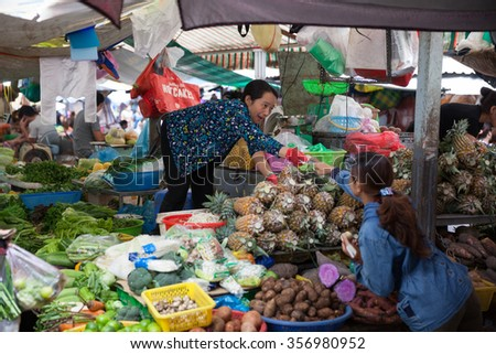 HO CHI MINH CITY, VIETNAM - NOVEMBER 21: Vietnamese woman is selling fruits and vegetables at the wet market on November 21, 2015 in Ho Chi Minh City, Vietnam.