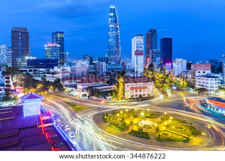 Ho Chi Minh City, Vietnam - November 21, 2015: View of the city after sunset with Bitexco Financial Tower on the background on November 21, 2015 in Ben Thanh Market area, District 1, Vietnam. - stock photo