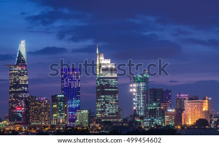 Ho Chi Minh City, Vietnam - OCT 14, 2016: Beautiful dusk over downtown of Ho Chi Minh City beside Saigon river by night, view from Thu Thiem Bridge.