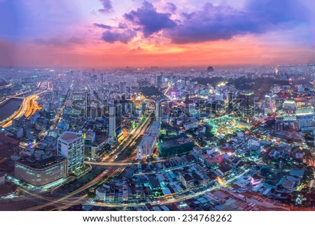 HO CHI MINH CITY, VIETNAM - OTC 29: Aerial night view of colorful and vibrant cityscape of downtown in Ho Chi Minh City with traffic light trails on OCT 29, 2014 - stock photo