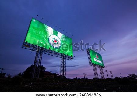 Ho Chi Minh City, Vietnam - 20 Sep 2014: An Advertisement of Heineken in Saigon's river - stock photo