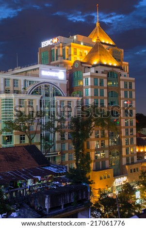 HO CHI MINH CITY, VIETNAM - 15 SEPTEMBER 2014: Saigon Metropolitan Towers, the office building in the central of the city, located in the corner of Nguyen Du and Dong Khoi streets by night - stock photo