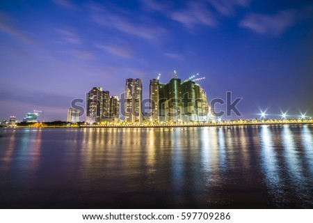 HO CHI MINH, VIET NAM - MAR 11, 2017: Ho Chi Minh city at night, view from a park in district 2, Sai Gon, Viet Nam.