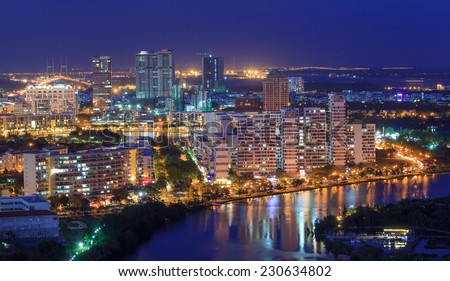 HO CHI MINH, VIETNAM - APRIL 3, 2014 : Phu My Hung Distric 7, Nam Sai Gon, Ho Chi Minh city night view with many new buildings aross the riverbank . Ho Chi Minh city is the biggest city in Vietnam.  - stock photo