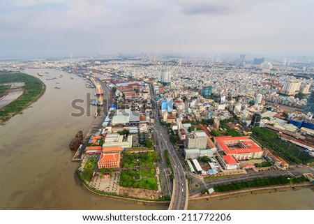 HO CHI MINH, VIETNAM - AUGUST 17, 2014. Panoramic view of Ho Chi Minh city or Saigon in sunset, Vietnam. Saigon is the biggest city and economic center in Vietnam. - stock photo