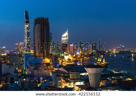 HO CHI MINH, VIETNAM - CIRCA JAN, 2016: Top view of Ho Chi Minh City at night. Ho Chi Minh, former Saigon, is located in the South of Vietnam, is the country's largest city, population 8 million. - stock photo