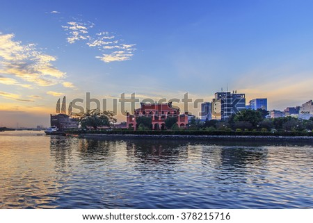 HO CHI MINH, VIETNAM - FEBRUARY 7, 2015 :Enjoy the Nha Rong wharf and Ben Nghe canal afternoon in Ho Chi Minh City (Saigon). - stock photo
