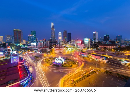 HO CHI MINH, VIETNAM - Jan 25, 2015. Downtown Saigon and Quach Thi Trang park in sunset, Ho Chi Minh city, Vietnam, near Ben Thanh market and Bitexco tower - stock photo