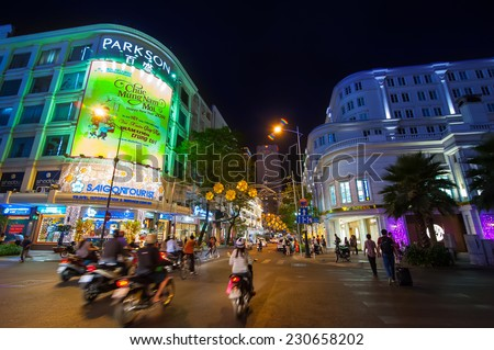 HO CHI MINH, VIETNAM - JAN 21, 2014: Scene of night life at Ho Chi Minh City (Saigon) the biggest city in Vietnam popular business center and modern tourist shopping - stock photo