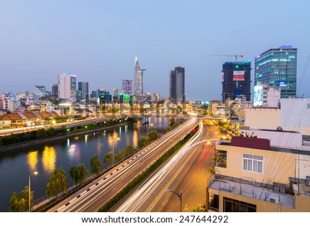 HO CHI MINH, VIETNAM - JANUARY 26, 2015 : Landscape lines running lights and rear Calmette bridge building is 68 floors high Betexco, Night Scene in Ho Chi Minh City (Saigon) is beautiful - stock photo