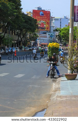 HO CHI MINH; VIETNAM - JANUARY 29; 2014: unidentified men selling flowers for Tet holiday