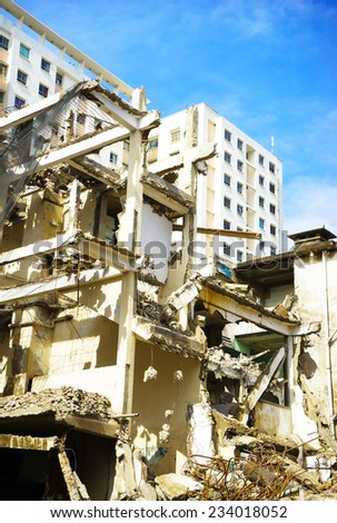 HO CHI MINH, VIETNAM - JULY 13: Pieces of Metal and Stone are Crumbling from Demolished Building Floors on July 13, 2014 in Ho Chi Minh, Vietnam.Hochiminh city is the most developed city of Vietnam - stock photo