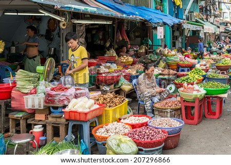 HO CHI MINH, VIETNAM - MAY 1: Unidentified people trading fresh and organic vegetables at Ong Lanh market on May 1, 2014 in Ho Chi Minh city, Vietnam. - stock photo