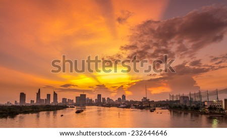 HO CHI MINH, VIETNAM - October 14, 2014: city center at sunset on riverbank in Hochiminh city, Vietnam on October 14, 2014. Ho Chi Minh city is the biggest city in Vietnam - stock photo