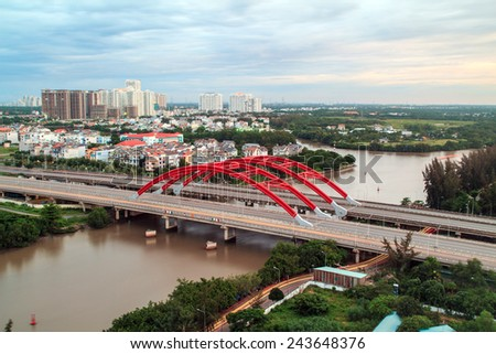 HO CHI MINH, VIETNAM - SEPTEMBER 08 , 2014 : Ariel view of ONG LON bridge across RACH DIA canal at sunset in District 7, Ho Chi Minh city. - stock photo