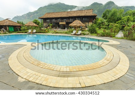 HOA BINH - VIETNAM MAY 29: Beautiful reflections at a resort pool in Hoa Binh province, Vietnam on May 29, 2016