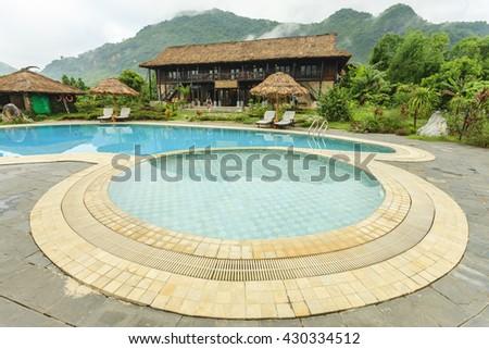 HOA BINH - VIETNAM MAY 29: Beautiful reflections at a resort pool in Hoa Binh province, Vietnam on May 29, 2016