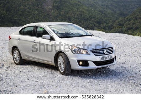 Hoabinh, Vietnam - Nov 16, 2016: Suzuki Ciaz sedan car is running on the mountain road in test drive in Vietnam.