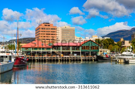 HOBART CITY, AUSTRALIA - 12 MARCH 2015: Franklin wharf in the downtown of Hobart City. Main quay is the most famous place for tourists and locals as well. Hobart, Tasmanian Island. Australia - stock photo