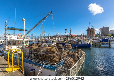 Hobart, Tasmania, Australia - January 16, 2015: Fishing Boats with lobster traps on boat in Franklin Wharf