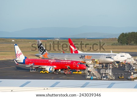 HOBART, TASMANIA/AUSTRALIA, MAY 11TH: Image of a Virgin Blue, Jetstar and Qantas passenger airliner at Hobart Airport on 11th May, 2014 in Hobart - stock photo
