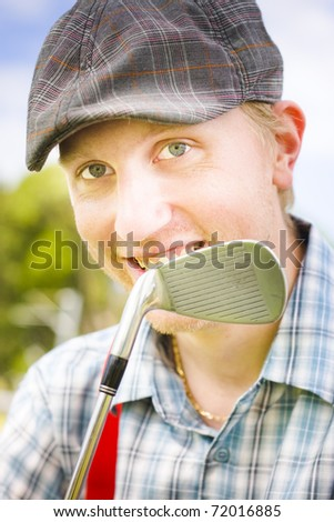 Hobby Golfer Man Smiling Behind His Golf Club During A Weekend 9 Hole Round At A Local Golf Course - stock photo