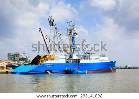 Hochiminh City, Vietnam - June 27, 2015: Transportation for export, at Cat Lai port import on Sai Gon river, boat crane to load containers, this is big harbor for trade service industry, Vietnam