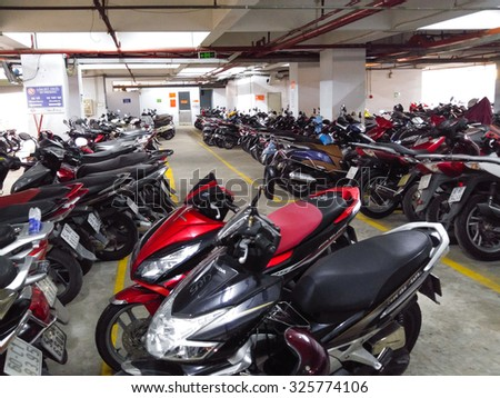 Hochiminh City, Vietnam - October 02, 2015: Tunnel to the motorcycle in a city apartment in HoChiMinh . Motorcycle is the main means clustering of transportation in this city  - stock photo