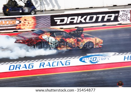 HOCKENHEIM - AUGUST 16 : Driver Tomi Pontinen performs a burnout during qualifying at nitrolympics drag racing event August 16, 2009 in Hockenheim, Germany. - stock photo