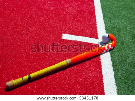 hockey stick on the field - stock photo