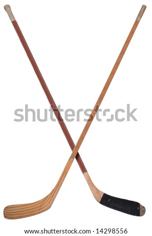 Hockey sticks crossed isolated over white - stock photo