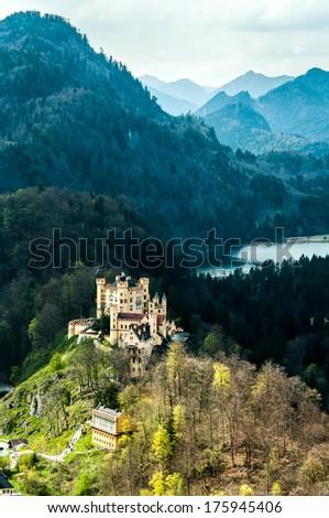 Hohenschwangau castle in the Bavarian Alps - Tirol, Germany (view from Neuschwanstein castle) - stock photo