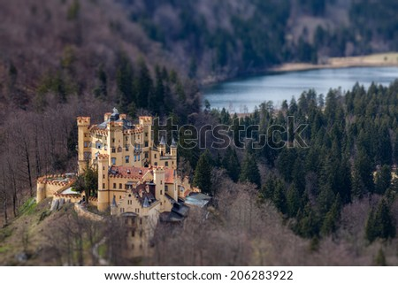 Hohenschwangau Castle (Schloss Hohenschwangau), Alpsee and Schwansee - aerial view from Neuschwanstein Castle with tilt shift toy effect shallow depth of field. Bavaria, Germany - stock photo