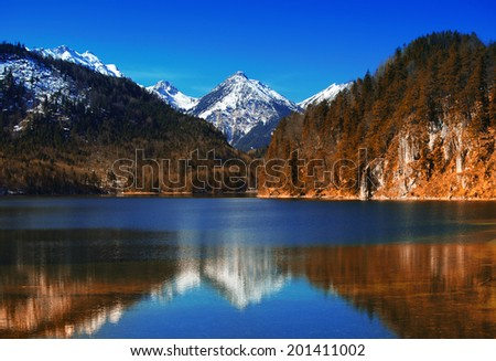 Hohenschwangau lake with bavarian alps in Germany - stock photo