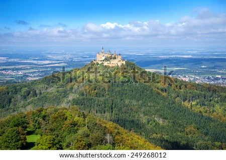 Hohenzollern castle in the beginning of autumn, taken from the viewpoint Zeller Horn in Baden-Wuerttemberg, Germany.  - stock photo