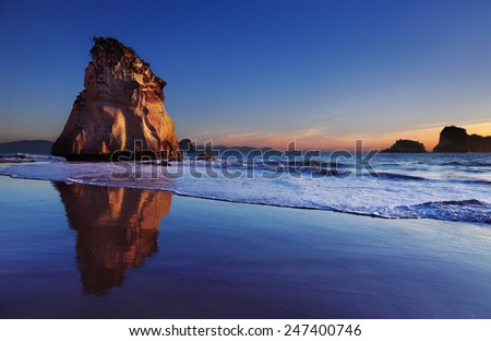 Hoho Rock at sunrise, Cathedral Cove, Coromandel Peninsula, New Zealand - stock photo