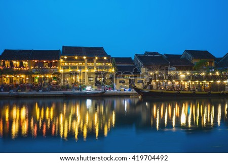 Hoi An ancient town viewing from Thu Bon river by twilight period. Hoi An is UNESCO world heritage, one of the most popular destinations in Vietnam - stock photo