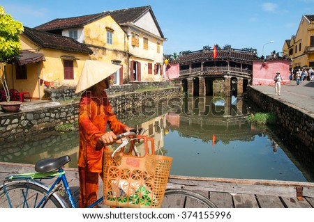 Hoi An, central Vietnam. February 25, 2013. . Ancient Vietnamese city of Hoi An. River in the city center. The background is a historic landmark Japanese Bridge. Hoi An, Vietnam