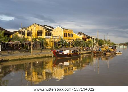 Hoi An riverside in Vietnam at sunset - stock photo