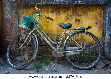 HOI AN, VIETNAM -APRIL 16:A bicycle parking on street in Hoi An, Vietnam. Bicycle is very useful and cheap vehicle at many cities in Vietnam. On April 16, 2014.