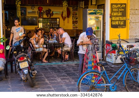 Hoi An, Vietnam - August 14, 2015: Caucasian tourists seated inside a cafe in Hoi An Ancient Town. - stock photo