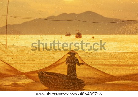 HOI AN, VIETNAM - JULY 17, 2015: An unidentified fisherman worked in fishing village of Cua Dai, Hoi An, Vietnam. Hoian is recognized as a World Heritage Site by UNESCO.